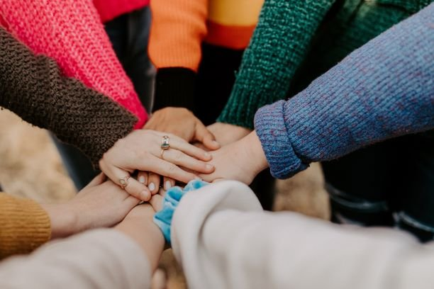 Multiple Hands coming together in a circle